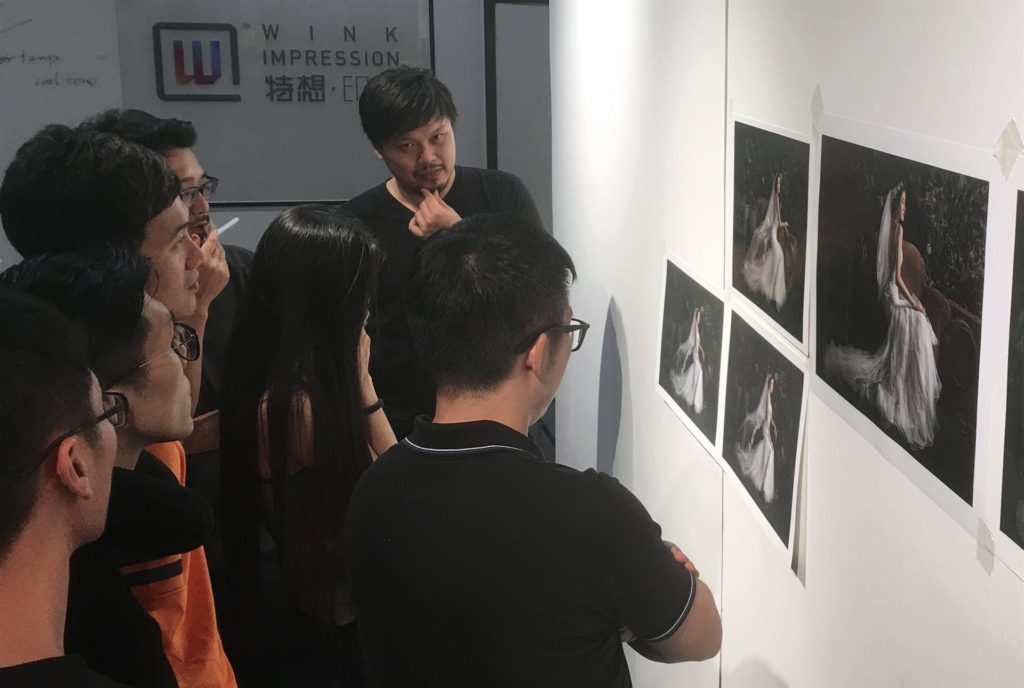Workshop participants comparing the details of different prints